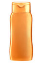 Figural shampoo bottle studio photography of orange plastic for isolated on white background Royalty Free Stock Image