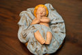 Figure of baby Jesus asleep wooden Royalty Free Stock Photo