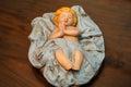 Figure of baby Jesus asleep wooden Royalty Free Stock Photo