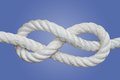 Figure eight knot the is a type of it is very important in both sailing and rock climbing as a method of stopping ropes from Royalty Free Stock Images