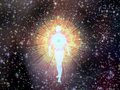 Figure emerges from cosmos the Royalty Free Stock Photo