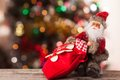 Figure of santa with a bag of gifts on the boke claus background bokeh Royalty Free Stock Photography