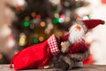 Figure of santa with a bag of gifts on the boke claus background bokeh Stock Image