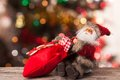 Figure of santa with a bag of gifts on the boke claus bokeh Royalty Free Stock Photography