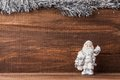 Figure of santa claus on old wood framed silver garland Royalty Free Stock Images