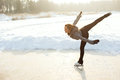 Figure skating woman at the frozen lake