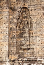 Figure in wall niche a large female is built into the bricks of a the east mebon temple near angkor wat the holes the brick Royalty Free Stock Images