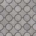 Figured pavement seamless tileable texture gray round and truncated square paving slabs Stock Photos