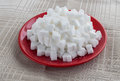 Figured white refined sugar on a red plate Royalty Free Stock Photography