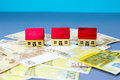 Figurine Houses With Banknote