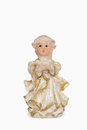 Figurine of a little angel praying dressed in white robes with gold dust isolated on white background Stock Photo