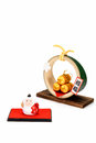 Figurine of Monkey and Three golden straw rice bags. Royalty Free Stock Photo