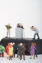 figurine of a politician speaking to the people