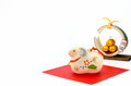 Figurine of Sheep and Three golden straw rice bags. Royalty Free Stock Photo