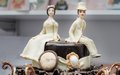 Figurines on wedding cake original top of Stock Photo