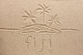 Fiji handwritten in sand for natural symbol tourism or conceptual designs Stock Photo