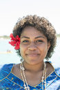 Fiji woman with hibiscus bloom friendly behind the ear and chain made from shells Stock Images