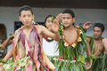 Fijian schoolboys danceing dance in traditional clothes made from leaves at a small island of the south see Stock Photos