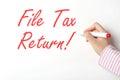 File tax return on whiteboard Stock Image