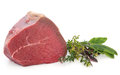 Filet of beef fillet meat joint with fresh herb sprigs over white background Stock Photography