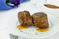 Filet mignon wrapped in bacon with sweet sauce Royalty Free Stock Photos