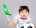 image photo : Baby son holding flag amd soccer ball