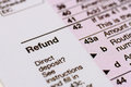 Filing taxes and tax forms close up of word refund on form Royalty Free Stock Photo