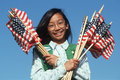 Filipino Girl Scout holding American flags Royalty Free Stock Photo