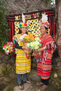 Filipino women wearing costumes two beautiful dress in traditional ifugao clothing of bright yellow and red woven patterns at Stock Photos
