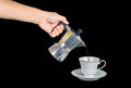 Fill the coffee hand hold moka pot into cup Royalty Free Stock Photography