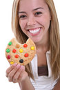 Fille mangeant le biscuit Photo libre de droits