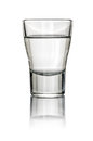 Filled shot glass on a white background Royalty Free Stock Images