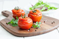 Filled tomatoes with rice and onions Stock Photos
