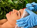 Filler injection for forehead face. Plastic aesthetic facial surgery. Royalty Free Stock Photo
