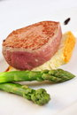 Fillet mignon grilled steak on bread slice and asparagus Royalty Free Stock Photos