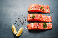 Fillet of salmon raw with sea salt and pepper fresh fish top view copy space food background Royalty Free Stock Images