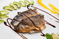 Fillet of white fish pan seared balsamico sauce and vegetables on background Stock Photos