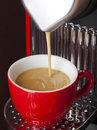 Filling a cup of espresso Stock Photo