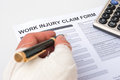 Filling up injury claim form a work Royalty Free Stock Photos