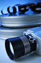 Film camera and movie film reel canisters Royalty Free Stock Photo
