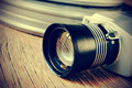 Film camera and movie film reel canisters, filtered Royalty Free Stock Photo