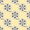 Film cinema technology seamless pattern vector twisted movie strip with round box roll illustration Royalty Free Stock Photo