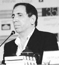 Film director mohsan makhmalbaf and writer at the press conference of his movie gardener held during the th moscow international Royalty Free Stock Photography