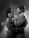 Film noir romantic couple embracing loving in the dark s style Royalty Free Stock Photography