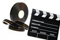 Film reel and cinema clap a black case a isolated on white Stock Photography