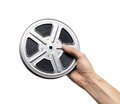 Film reel motion picture in man s hand Stock Photography