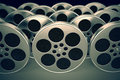 Film reels row of new reflective spools with tape on dark background Royalty Free Stock Photos