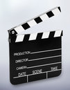 Film slate in front of a background with shadow at the bottom Royalty Free Stock Photo
