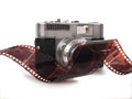 Film strip and camera Royalty Free Stock Photo