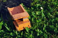 Filtered vintage orange car toy truck on green grass detail Royalty Free Stock Photo